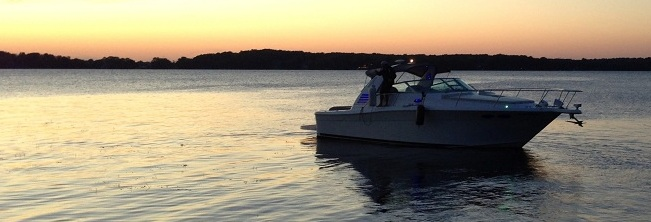 Sunset and boat on Lake Minnetonka