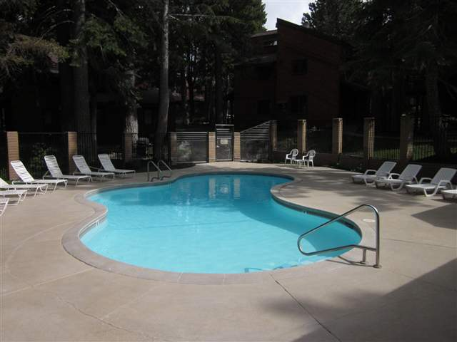 Meadowridge condos pool in summer