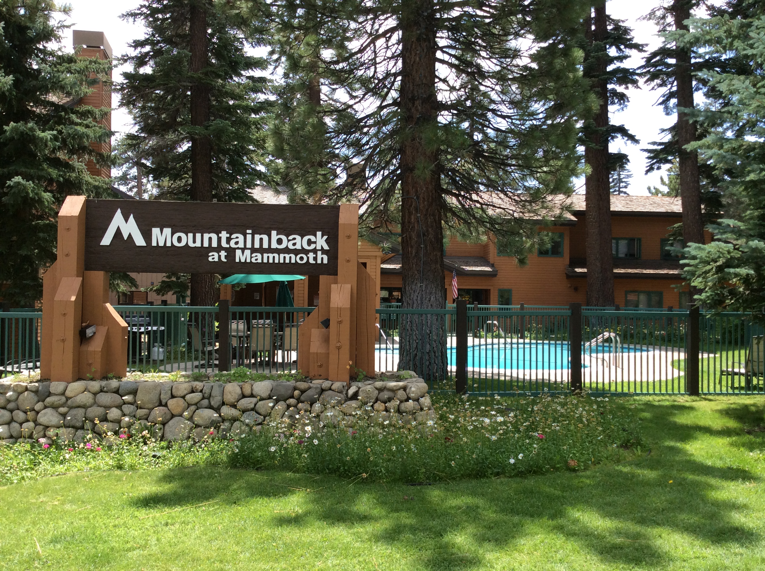 Mountainback Condos Complex Sign and Pool in Summer