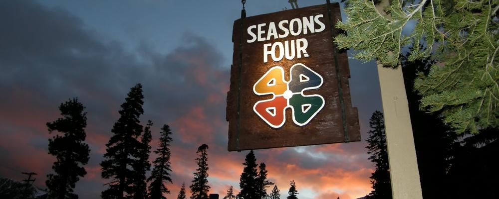 Seasons 4 Condo Complex Sign at Dusk