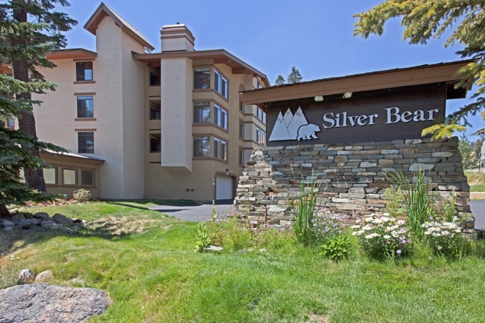 Silver Bear Condo Complex During Summer and Sign