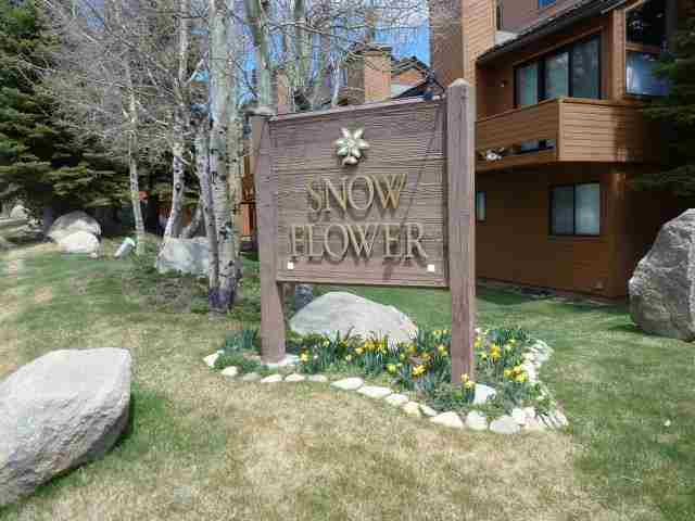 SNOWFLOWER CONDOS IN THE MEADOW ENTRANCE AND SIGN