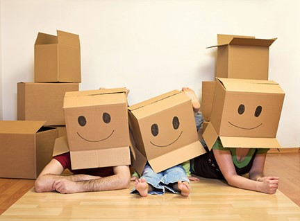 Moving boxes with smiley faces on people's heads
