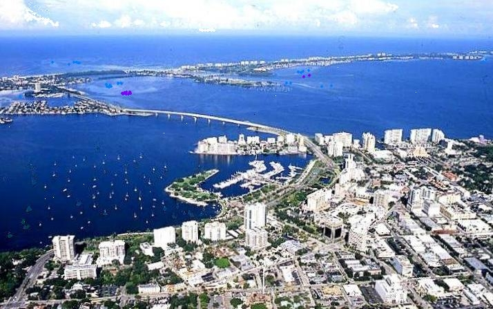 Ariel view of Sarasota - Image Credit: http://en.wikipedia.org/wiki/File:Sarasota_Florida_-_83d40m_-_from_mainland_across_bay_front_to_Gulf_of_Mexico_-_new_bridge.JPG