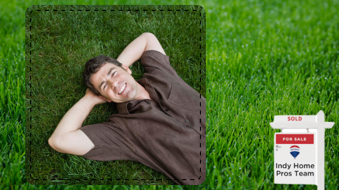 man lying on his spring lawn enjoying his lawn care efforts