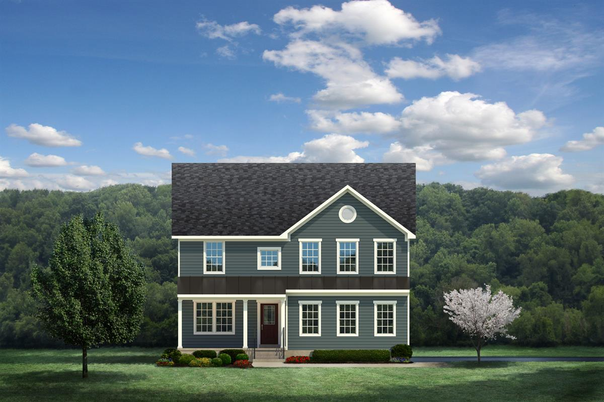 Front of a Ryan Homes Home, Green exterior in forefront with Forest backdrop. Colonial Style Home.