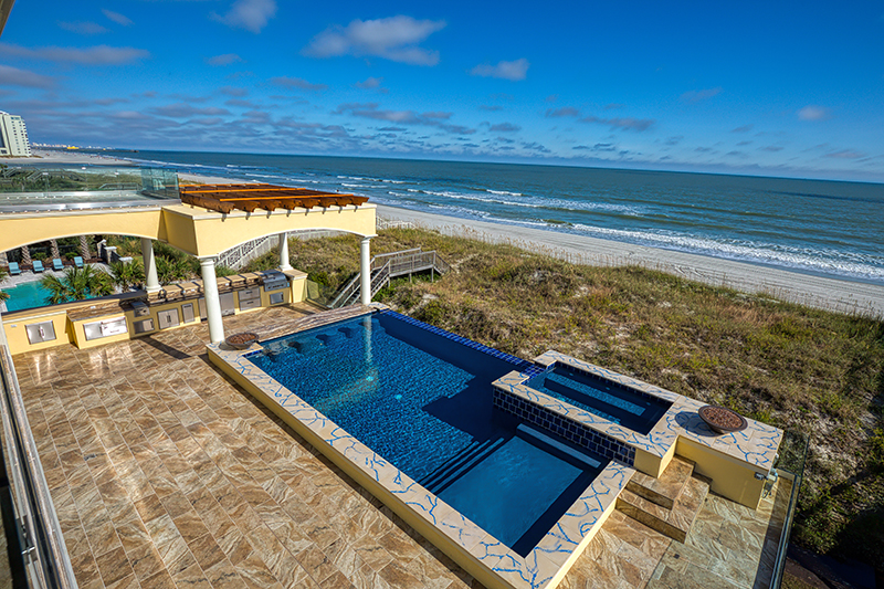 Oceanfront pool with outdoor kitchen and hotter with fire elements