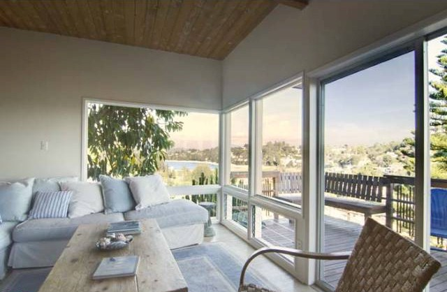 1768 rotary living room has terrific views of the Silver Lake hills