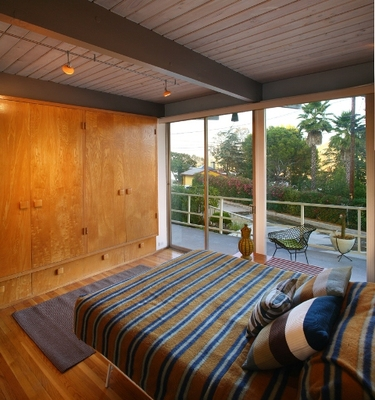 1973 REDESDALE bedroom with wall of glass and beamed ceiling