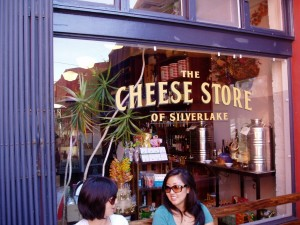 Customers chatting in front of Silver Lake's Cheese shop