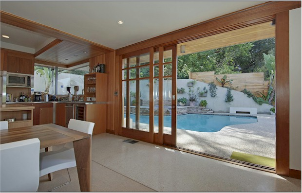 Los Feliz architectural - dining room opens to inviting pool