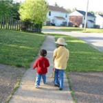 Children walking in the neighborhood.