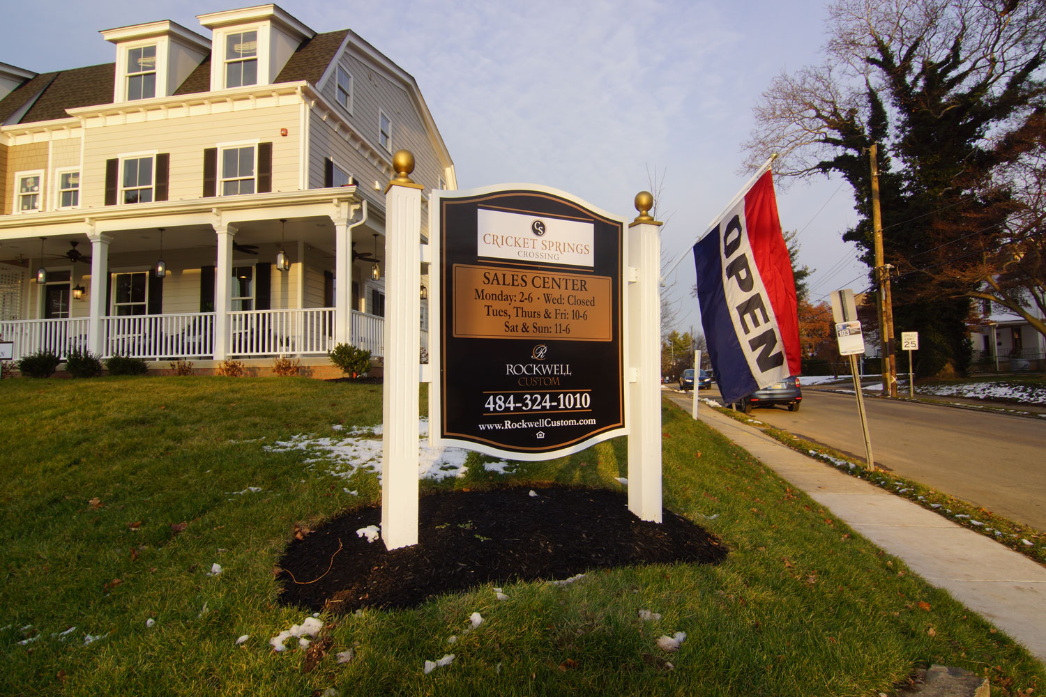 The sign and front of the model building of the Cricket Springs Crossing townhouse development in Ardmore, PA