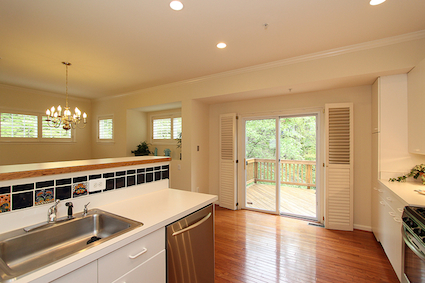 The kitchen in this Kensington Townhome opens to the dining room and has deck access as well.