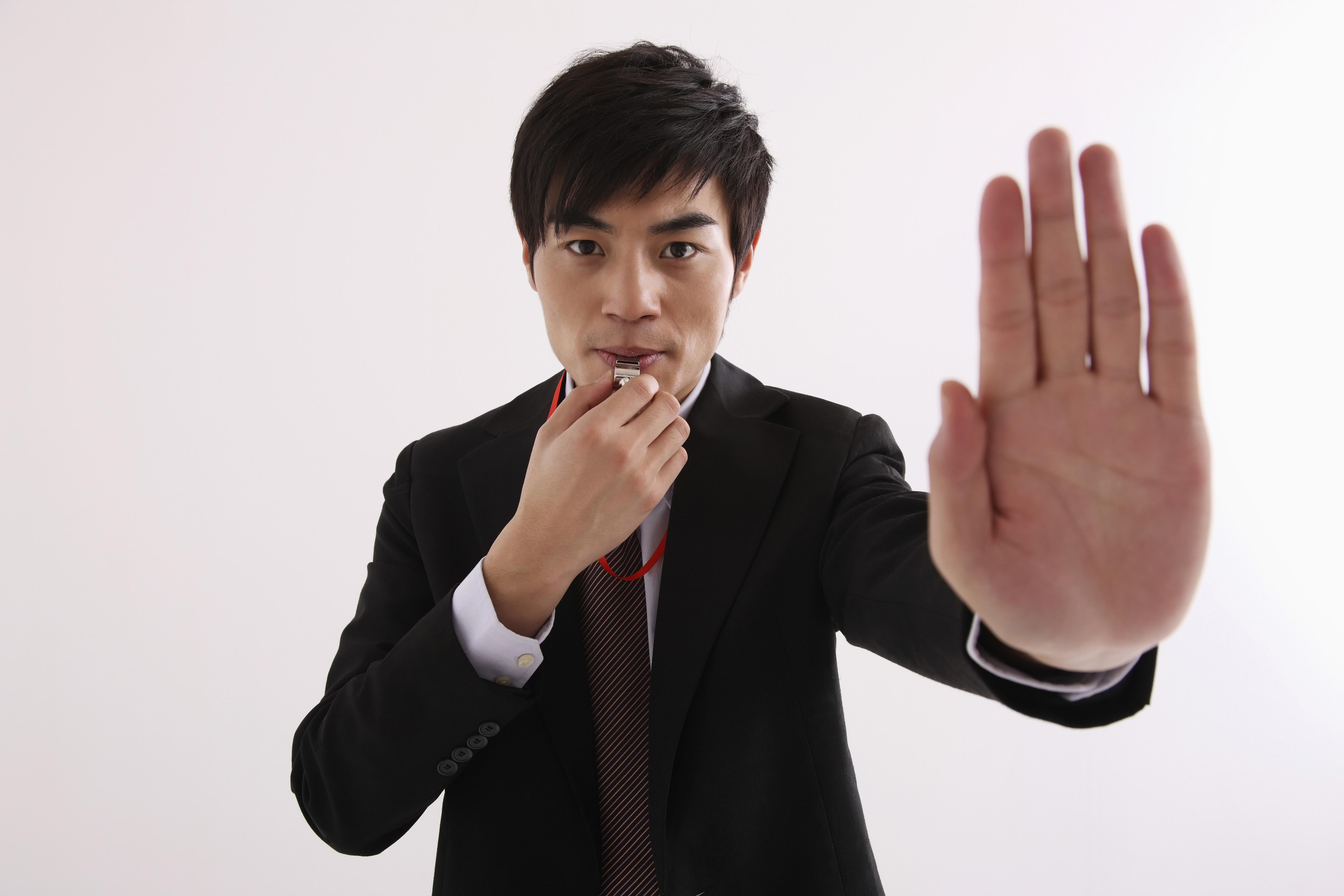 man holding hand up