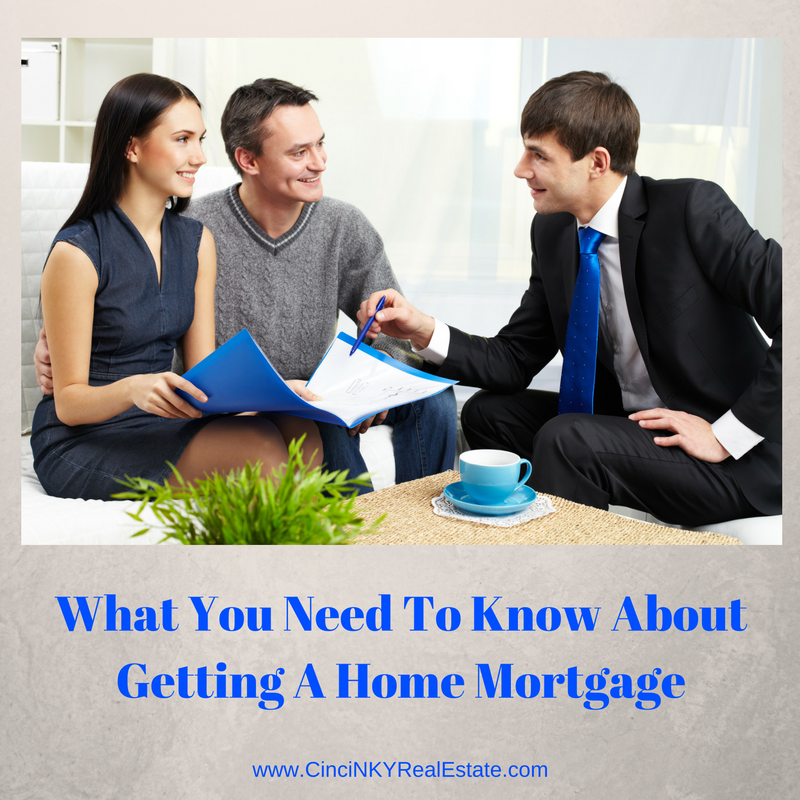 What you need to know about getting a home mortgage picture of young couple with mortgage lender