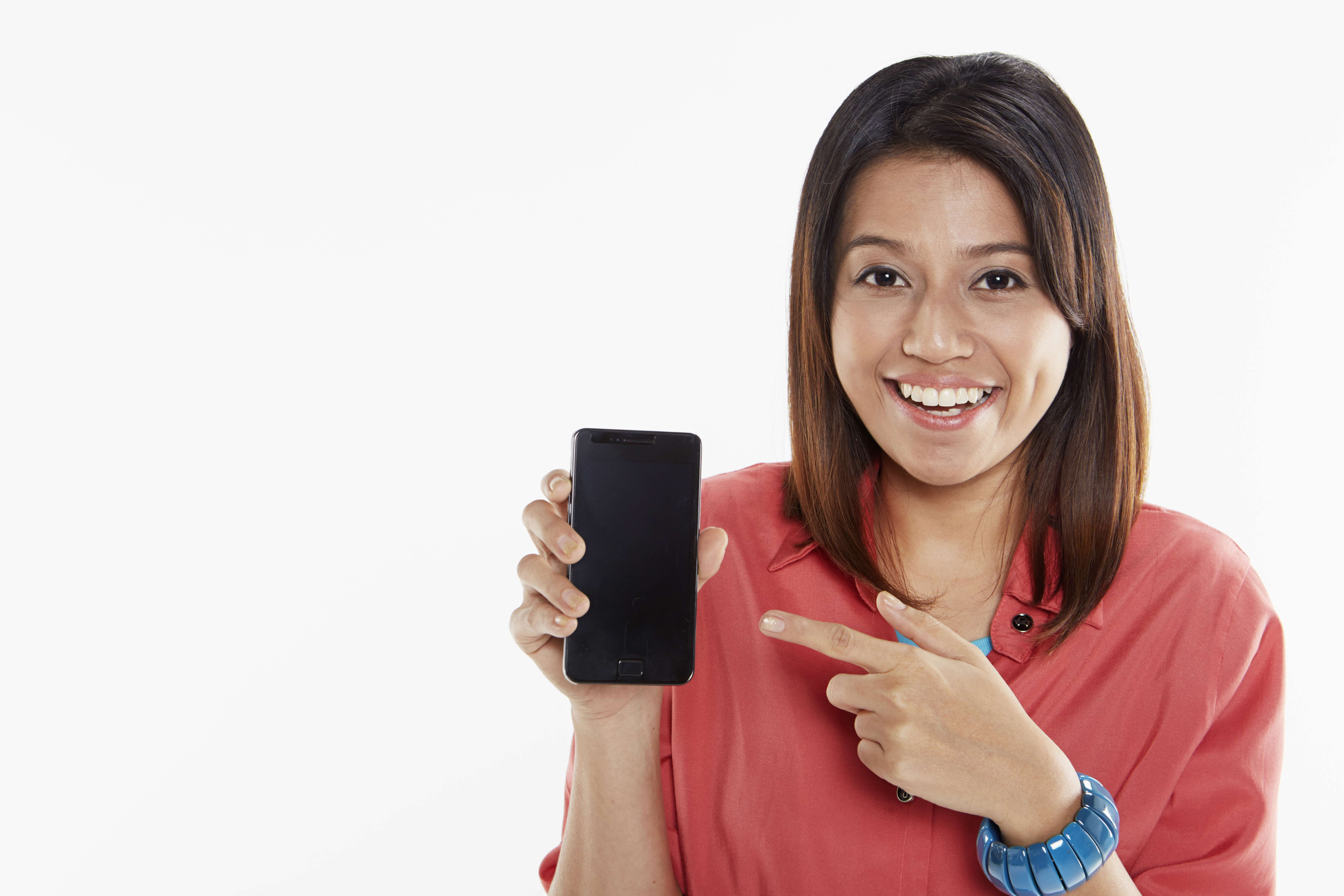 woman using her phone to control her home