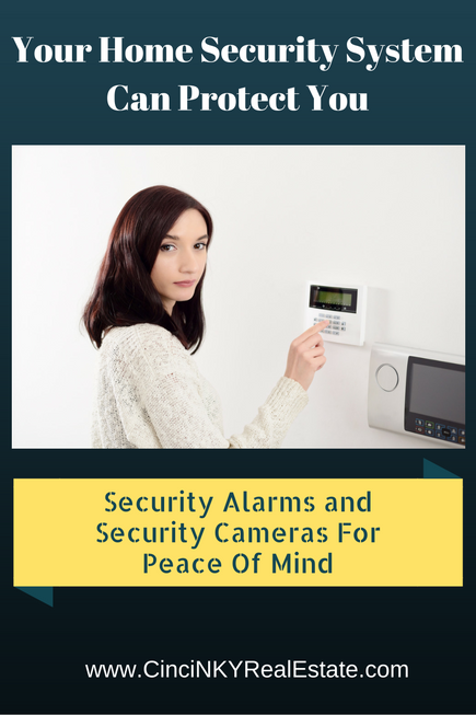 picture of woman punching in security code for section about security alarms being able to protect you during selling your home