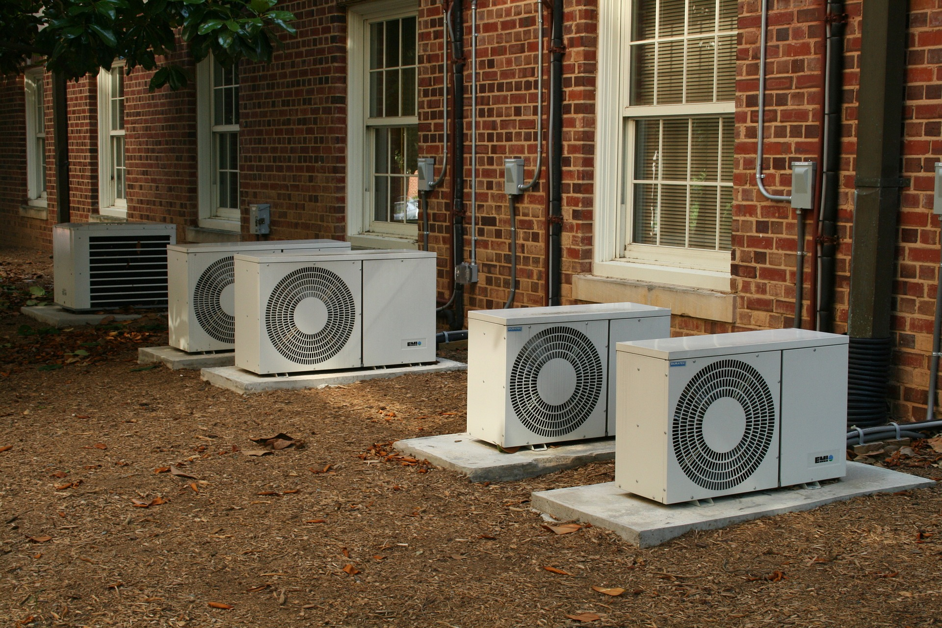 picture of compressors outside homes