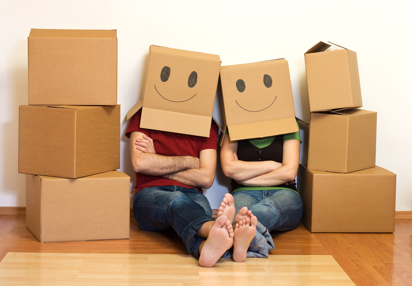 happy box couple moving into house after successful walkthrough