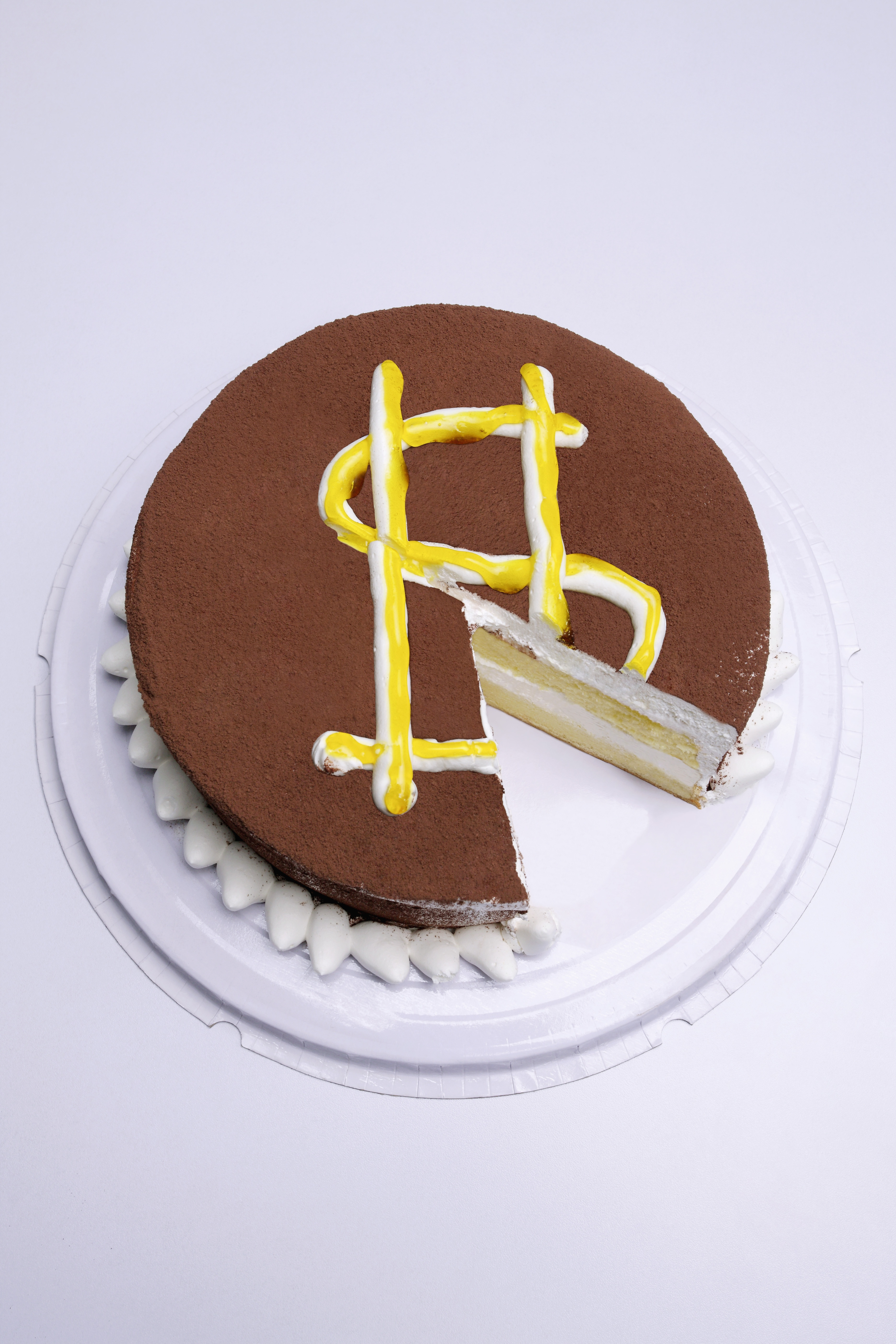 cake with missing piece and missing dollar sign