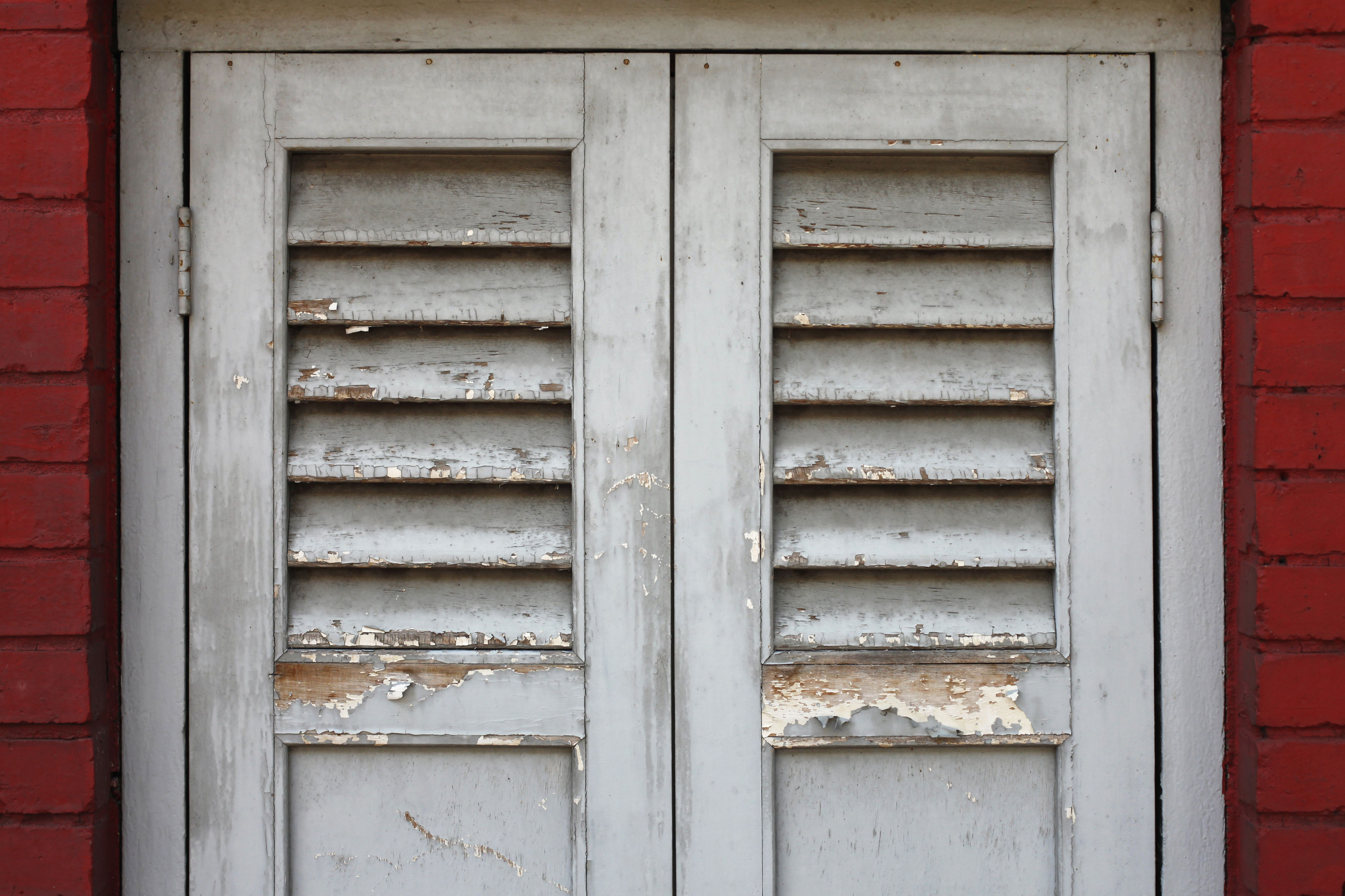 old wood door with peeling lead paint