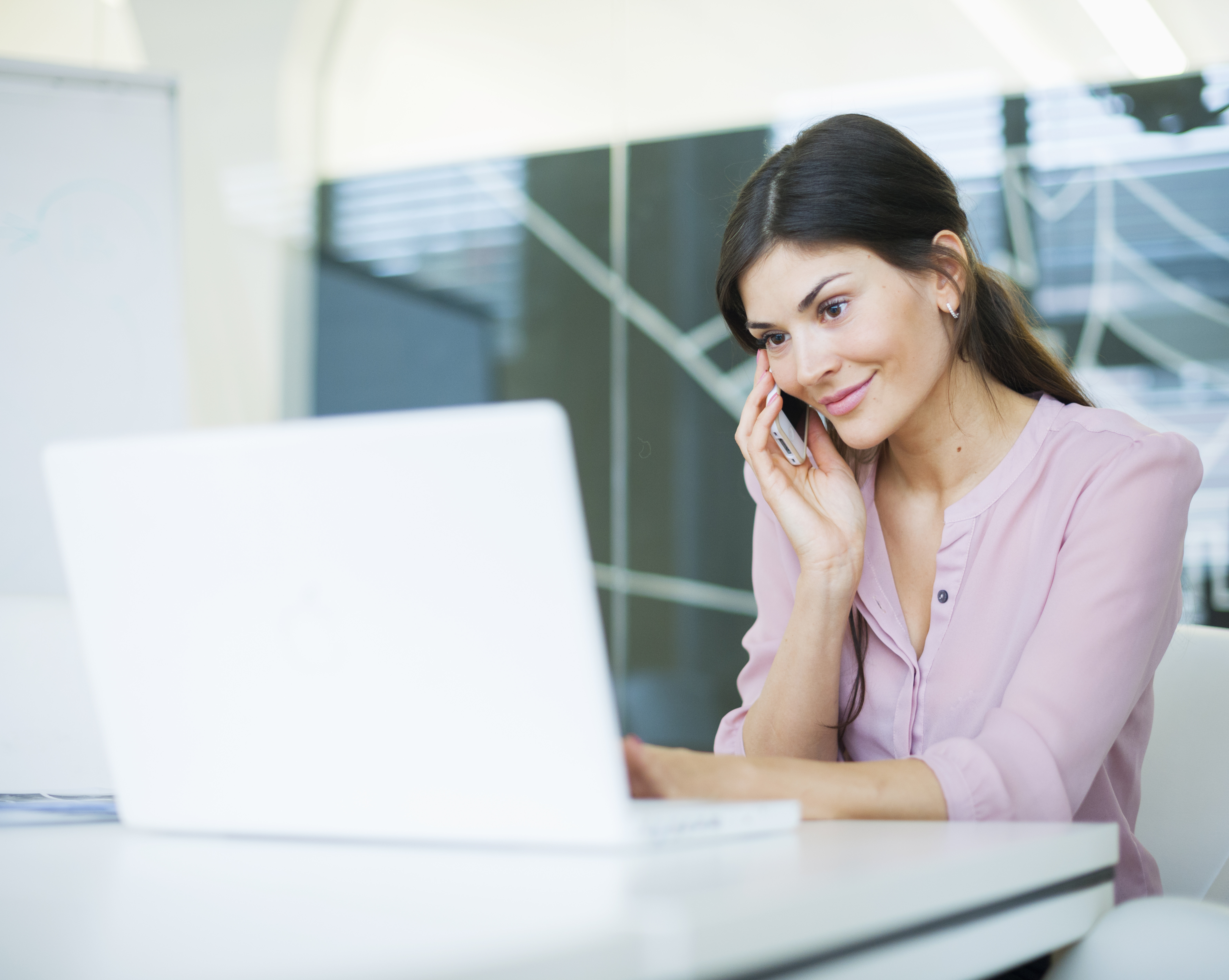 woman talking on phone with lender