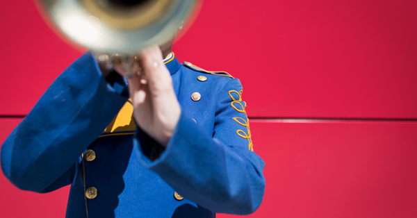 Marching Band Member Blowing Brass Horn