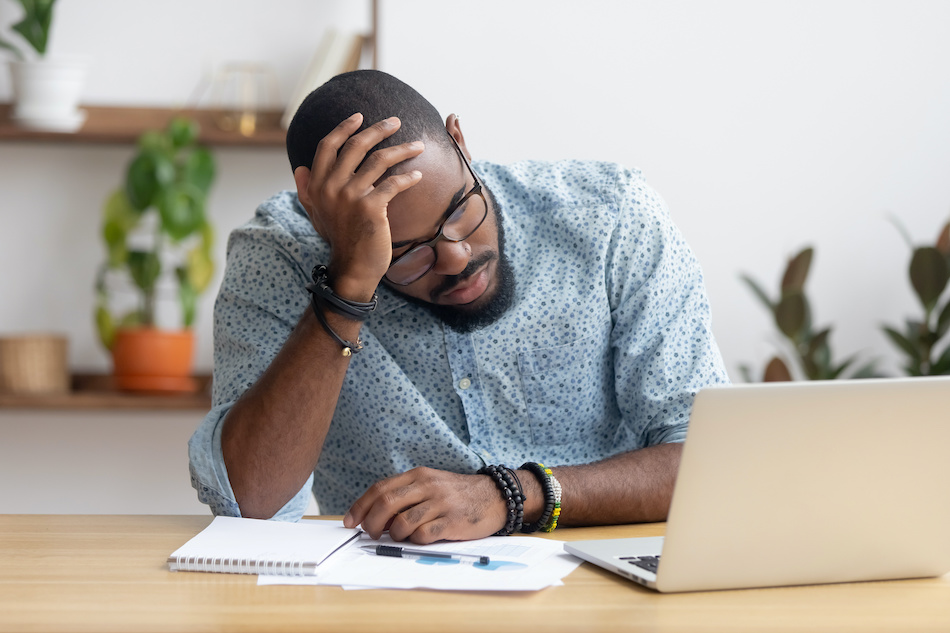 Man stressed out dealing with financial stress