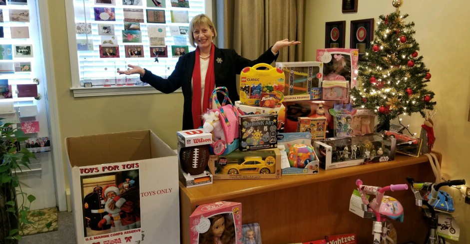 Joleen Rose with toys she helped collect.