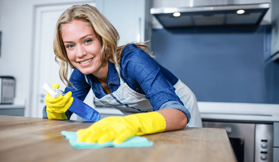 11 Things People With Ultra-Clean Homes Do Every Single Day Woman Cleaning Image