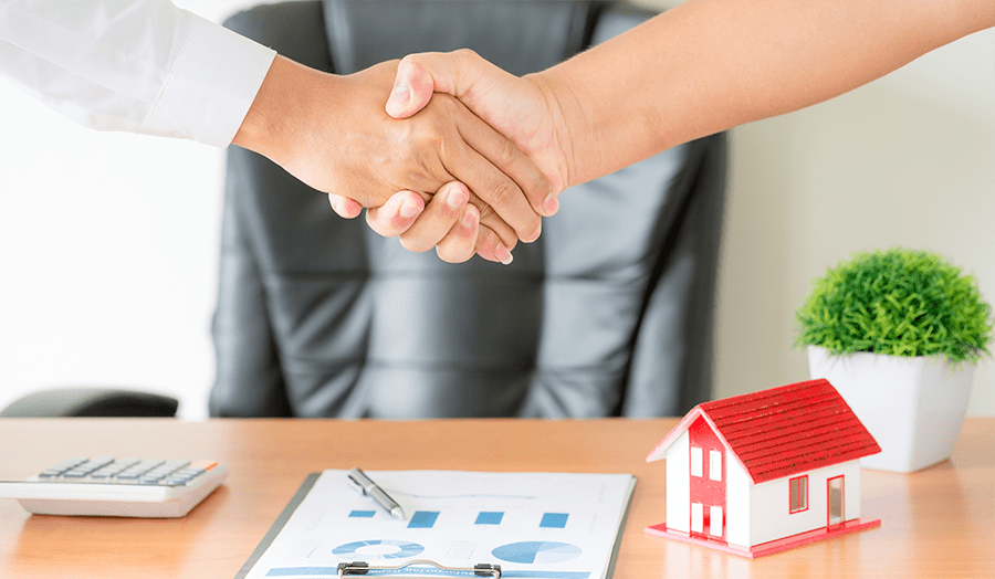 Four Essential Tips For Reducing Home Selling Stress Hand Shake Image