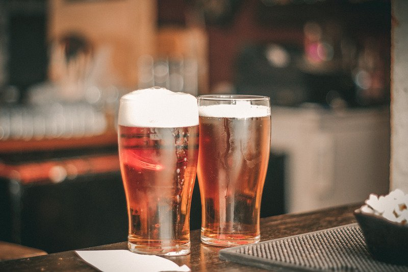 Two beers on a bar