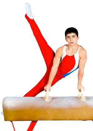 Boy gymnast performing on the pommel horse.