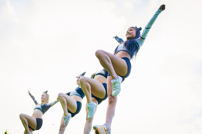 cheerleaders perform stunt