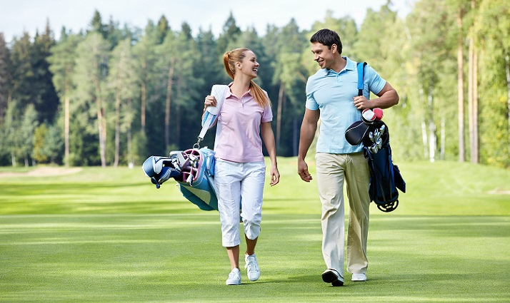 couple enjoying conversation and golf