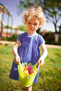 Little girl hunting Easter eggs