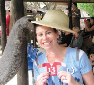 Kristie Smith with an elephant and Flat Chuck