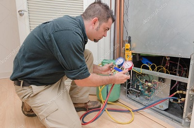 HVAC technician working on furnace
