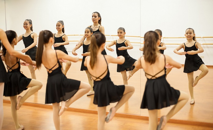 Young Indianapolis girls practice ballet dancing
