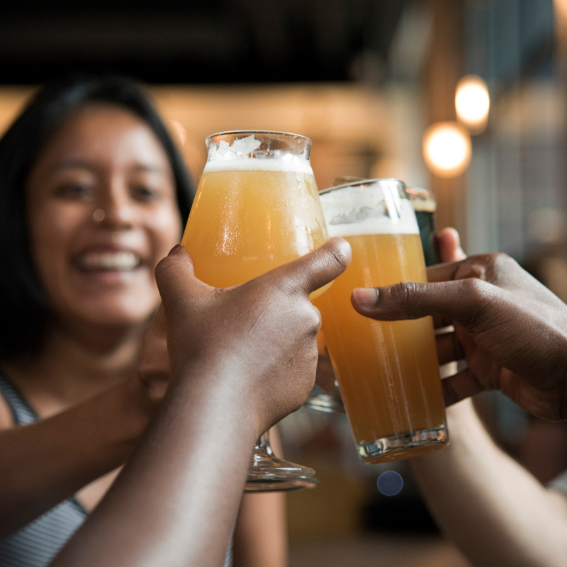 Happy beer lovers toasting each other