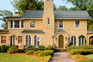 Large stucco house with ocher paint
