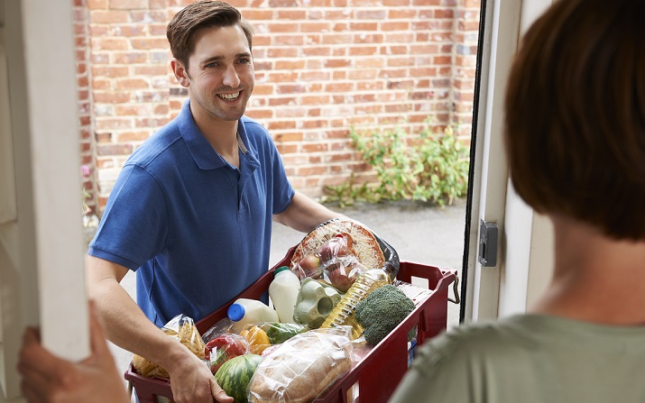Young man delivering groceries