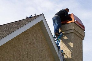 Man inspecting chimney for damage.