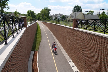 Father and son biking on Monon Trail