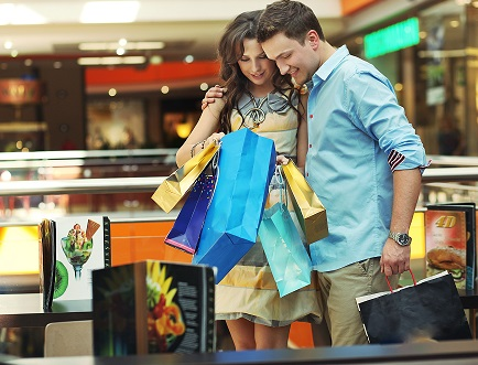 young couple shopping at a mall