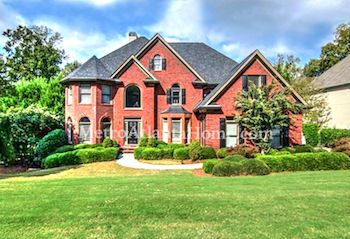 A large brick home for sale in the Amberfield neighborhood.