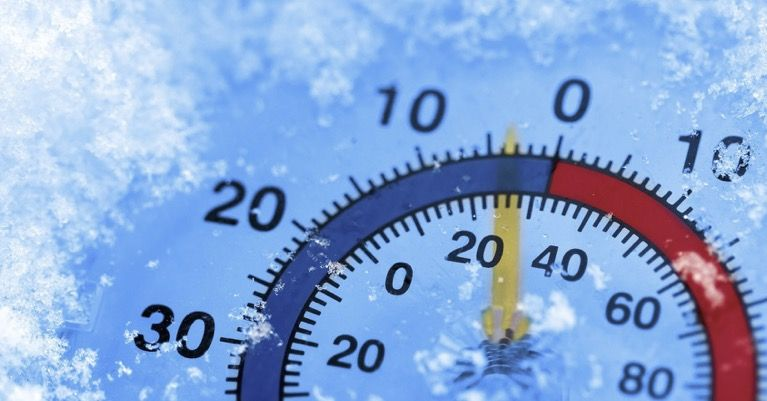 Temperature gauge with ice showing sub-freezing temperatures.