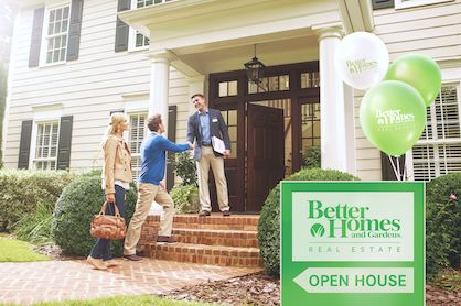 Potential home buyers attending an open house while exploring new neighborhoods.