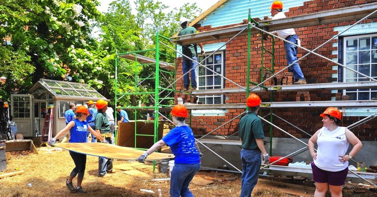 Volunteer workers at a Rebuilding Together home renovation project.